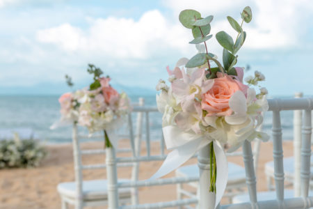 Cute flowers on chiavari chairs for outdoor wedding ceremony