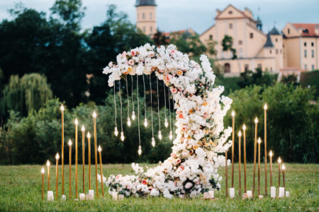Moon shaped flower sculpture for outdoor wedding
