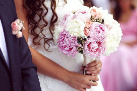 Fun modern and elegant bridal bouquet with pink, white, and purple peonies.